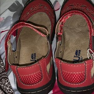 One pair shoes red color